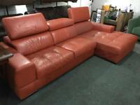 As orange leather new corner sofa