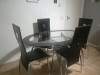 Glass Oval Table with Four Matching Chairs