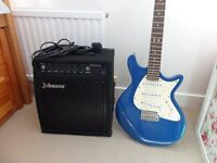 Electric guitar and amplifier with accessories.