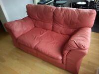 Flamingo pink two seater sofa
