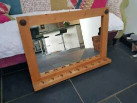 "Large mirror 35.5"" by 24"" with nine candle holders."