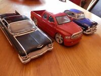 Collection of 3 1.24 scale die cast car models