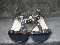 Ladies black/gold studded sandals for sale - brand new