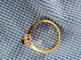 Gold ring with sapphire stone