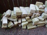 3.0 to 3.5 square metres of cut sandstone blocks, real sandstone
