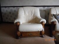2 armchairs and 3 seat sofa ivory leather on a mid oak carved base with drawers to each