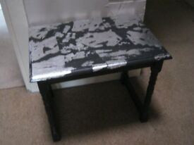 Shabby chic side table in black with applied silver leaf