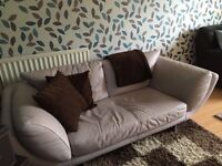 Cream/Pale Pink Two-Seater Leather Sofa with metal feet
