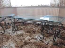 Glass top set of 3 coffee tables with ornate gun metal legs