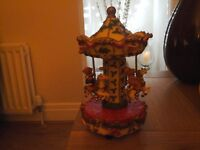 Christmas musical carousel windup not battery verygood condition