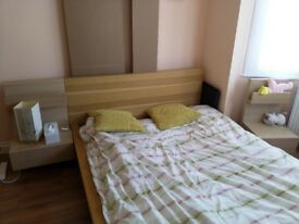 IKEA double bed with bedside tables