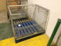 Folding galvanised wire stacking cages for pallets.