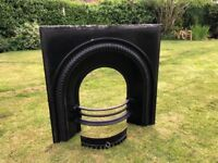 Cast iron fireplace insert and hearth