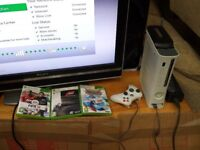 xbox 360 console with 120gb hdd, 7 games, 1 controller, hdmi cable, power supply and wifi adapter