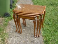Vintage nest of 3 coffee tables with glass tops and a small drawer