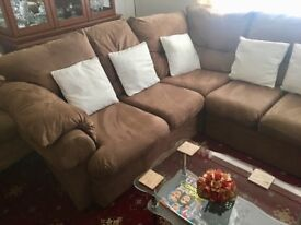 Immaculate suede corner sofa