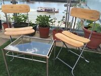For sale, two outdoor patio chairs and glass table to suit patio, balcony, terrace, garden