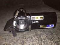 great wee hand held hd video camera with good battery life and charger and case.