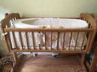 Bassinet with mattress , bumpers, and wooden rocking holder