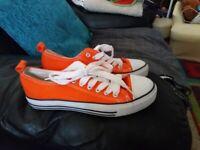 orange trainers/shoes