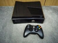 XBOX 360 console + 1 wireless controller + 9 games (medal of honor) + cables + 1 USB controller