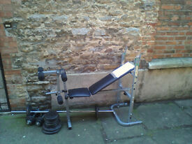 Weight bench and weights aprox 80Kg with chromed long bar and 2 x chromed dumb bell bars