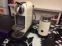 Nespresso machine, milk frother and pods