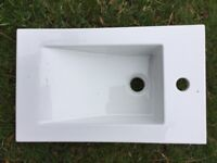 Brand new, boxed, white vanity sink. Rectangle in shape.