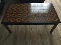 This is a 1980's hardwood tiled brown coffee table in good condition