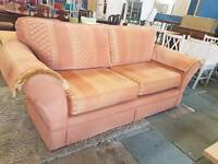 Orange patterned fabric two seater sofa