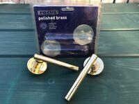 Pair of brass door handles - unused, in packaging, excellent condition