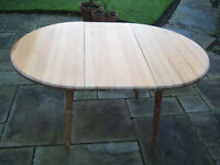 Circular pine dining table with central panel to convert to oval