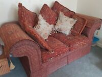 Deep Red/Rust 2 seater sofa. Very comfortable