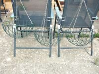 7 x Metal hanging baskets : 4 x green + 3 x black (with makeshift liners). N.B. No soil or flowers