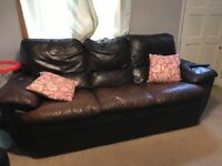 Brown leather sofa and two reclining chairs