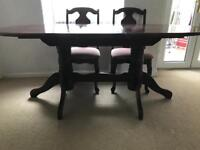 Extending Dining Table and 4 Chairs.