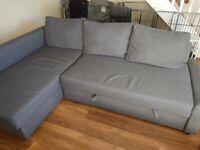 Used corner sofa-bed with storage