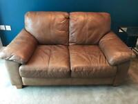 DFS leather two seater sofa and footstool