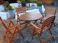 WOODEN PATIO SET WITH 4 CARVER CHAIRS AND TABLE ALL FOLDS FOR STORAGE ONLY £60 FOR QUICK SALE