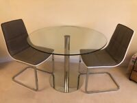 Glass bistro style table and 2 chairs