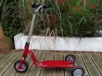 Child's red/silver 3-wheel scooter