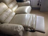 Cream leather 2 seater sofa , in good condition.