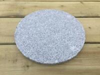 Circular granite Chopping board serving food preparation kitchen