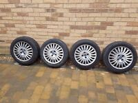 Set of 4 Fiat Punto 15 inch wheels with covers