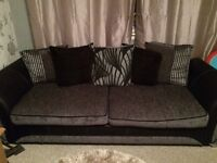 4 seater black and silver sofa