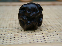 BEAUTIFUL LOOKING WOODEN NETSUKE IN THE FORM OF A PIG