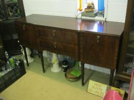 ORNATE SHAPED SIDEBOARD. TWIN CENTRAL DRAWERS, MATCHING END CABINETS. VIEWING/DELIVERY AVAILABLE