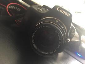 Canon EOS 100D 18.0MP DSLR with lenses