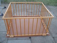 Classic wooden foldable play pen with floor.