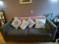 Two seater sofa for sale.